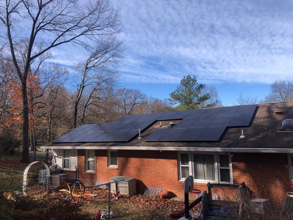 Installation of solar PV panels on a low-pitch roof in Alexandria County, Virginia